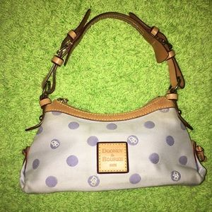 Small purple polka dot Dooney and bourke handbag.